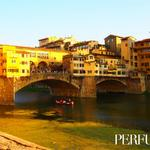 Another day in Florence comes to a close as the late afternoon sun hits the Medieval Ponte Vecchio.